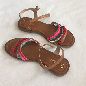 Stylish pink,red, and teal summer sandals.